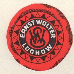 Altes Logo des Spirituose- und Getränkehandels Ernst Wolters in Lüchow.